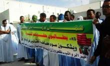 صورة من احتجاج العمال بحر الأسبوع الماضي أمام مكاتب مشغلهم