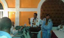 محمد عبد الله بليل يلقي العرض باسم فريق العمل المكلف بالبعد الثقافي للراحل.